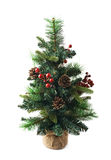 Small artificial Christmas tree isolated Royalty Free Stock Photography