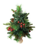 Small artificial Christmas tree isolated Royalty Free Stock Photo