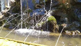Small artificial small waterfall, slowly dripping water drops. Outdoor footage stock footage