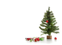 Small artificial tree with ornaments on white Royalty Free Stock Photography