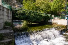 A small artificial waterfall stock photo