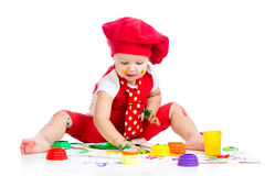 Small artist child painting with finger Stock Image