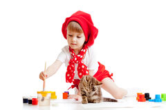 Small artist child painting. Kitten sitting near Stock Photo