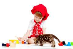 Small artist child painting. Kitten sitting near Royalty Free Stock Images