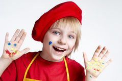 Small artist in a red beret Stock Photography