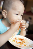 Small asian baby boy eating spaghetti Royalty Free Stock Photos