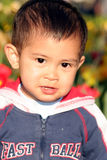 Small asian boy. Outdoor portrait of one small asian boy Royalty Free Stock Photo