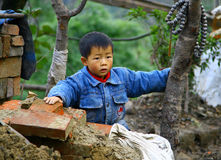 Small Asian boy at a construction site Royalty Free Stock Photo