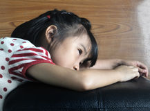Small asian child feel lonely Royalty Free Stock Photos