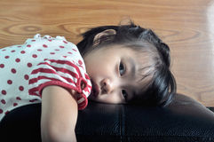Small asian child feel lonely in sofa Stock Photo