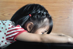 Small asian child feel lonely in the sofa Stock Photo
