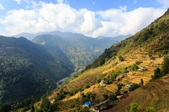 Small asian mountain village and terrace fields in autumn in Nepal, Himalaya, Annapurna Conservation Area royalty free stock images