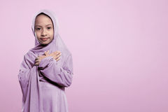 Small asian muslim girl in hijab with peaceful expression Royalty Free Stock Photography