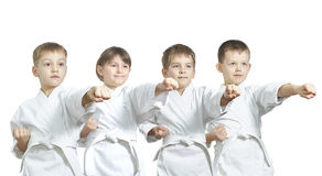 Small athletes are hitting punch. Athletes are hitting punch arm Royalty Free Stock Photos