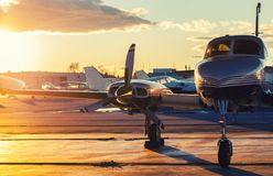 Small Aviation: Private Jet is Parked on a Tarmac in a Beautiful. Sunset Light Royalty Free Stock Image