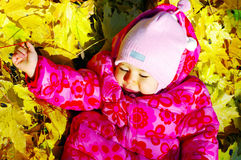 Small baby in autumn forest Stock Photography