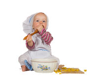 Small baby baker tasting the baking Stock Photos