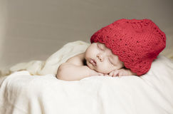 Small baby in bed stock images