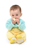 Small baby biting apple Royalty Free Stock Photos