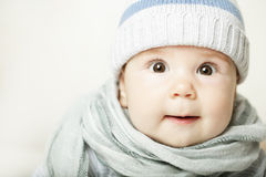 Small baby in blue cap Stock Photo