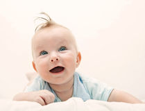 Small baby with blue eyes Royalty Free Stock Photography