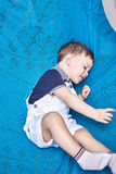 Small baby boy blond hair interior commercial blanked Stock Photo