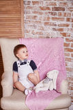 Small baby boy blond hair interior commercial blanked Stock Image