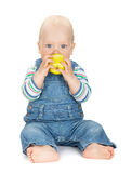 Small baby boy eating an apple Royalty Free Stock Photography