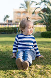 Small baby boy with happy face on green grass barefoot Stock Photo