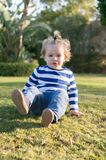 Small baby boy with happy face on green grass barefoot Stock Images