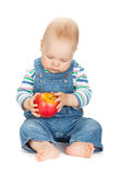 Small baby boy holding an apple Stock Images