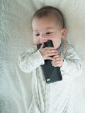 Small baby boy holding smartphone  Stock Image