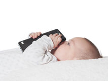 Small baby boy holding smartphone isolated Royalty Free Stock Images