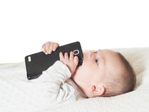 Small baby boy holding smartphone isolated Stock Images