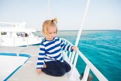 Small baby boy sailor, captain of yacht in marine shirt Stock Photography