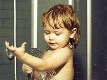 Small baby boy in shower royalty free stock images