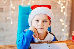 Small baby boy writes a list of gifts Stock Images