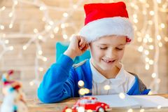 Small baby boy writes a list of gifts Stock Photography