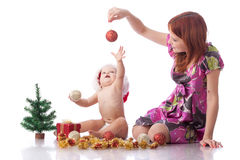 Small baby with christmas decoration. Sweet small baby with christmas decoration on a white background Stock Images