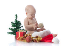 Small baby with christmas decoration Stock Image