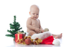 Small baby with christmas decoration Royalty Free Stock Photography