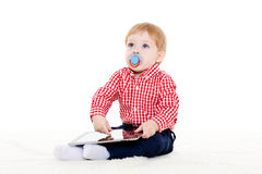 Small baby with computer tablet. Royalty Free Stock Image