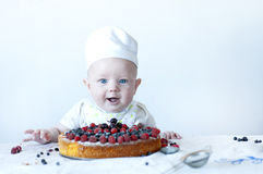 Small baby confectioner. Stock Photos