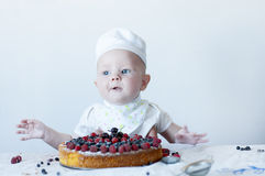 Small baby confectioner. Royalty Free Stock Photos