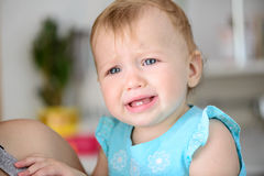 Small baby crying. Small baby is crying hard. Tears stream down her cheeks Royalty Free Stock Photos