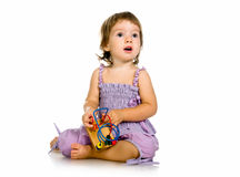 Small baby with developmental toy Stock Image