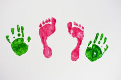 Small baby feet and hands. Imprint on the wall stock photos