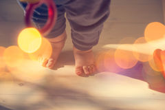 Small Baby Feet on Wooden Floor Stock Photography