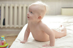 Small baby girl on bed Stock Image