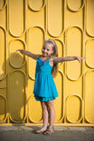 Small baby girl with happy face in blue dress outdoor Royalty Free Stock Photography